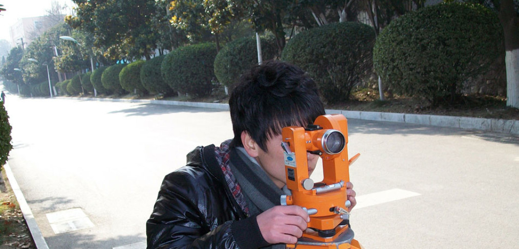 Surveyor at work in residential area.